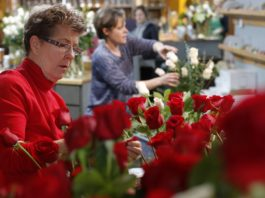At Kroger, a dozen roses at stores usually cost around $10. During the Valentine's Day stretch, they go for double.
