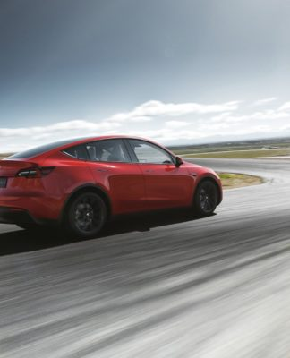 Tesla's new Model Y mid-sized SUV will begin shipping in 2020.