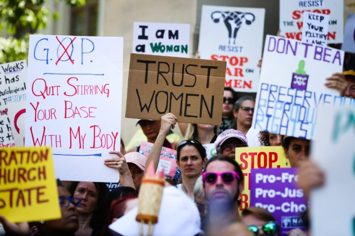Top executives from more than 180 companies have a message for lawmakers: Restricting abortion is